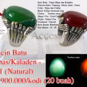 Cincin Batu Topas/Kaladen - PC1 (Natural) Rp.900.000/kodi (20 buah) Spesifikasi: Jenis Batu : Topas Hijau dan Kaladen Dimensi Batu: Panjang: 18mm, lebar: 13mm Color: Hijau dan Coklat Berat: 8,8/pcs termasuk ring Clarity : Tembus sinar Shape / Cut : Oval Cabochon Origin : Impor Cina Treatment : Natural Jenis Ikatan: Rhodium Size Ikatan : 16 - 20